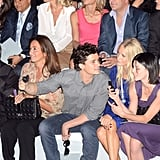 Orlando Bloom chats during Paris Fashion Week.