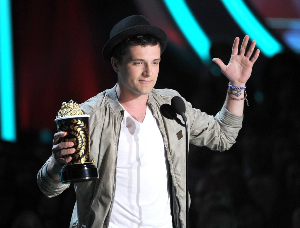 Josh Hutcherson lept up to the stage and accepted his popcorn.