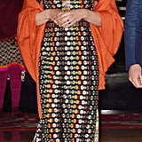 At dinner with the King and Queen of Bhutan, a tangerine pashmina really made the orange in Kate's Tory Burch gown pop.