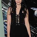 Lily Collins in a black dress at the Abduction premiere in London.