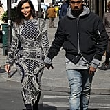 Kim took the streets of Paris in a black and white detailed maxi dress.