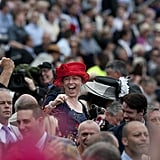 A lady cheered in the crowd.