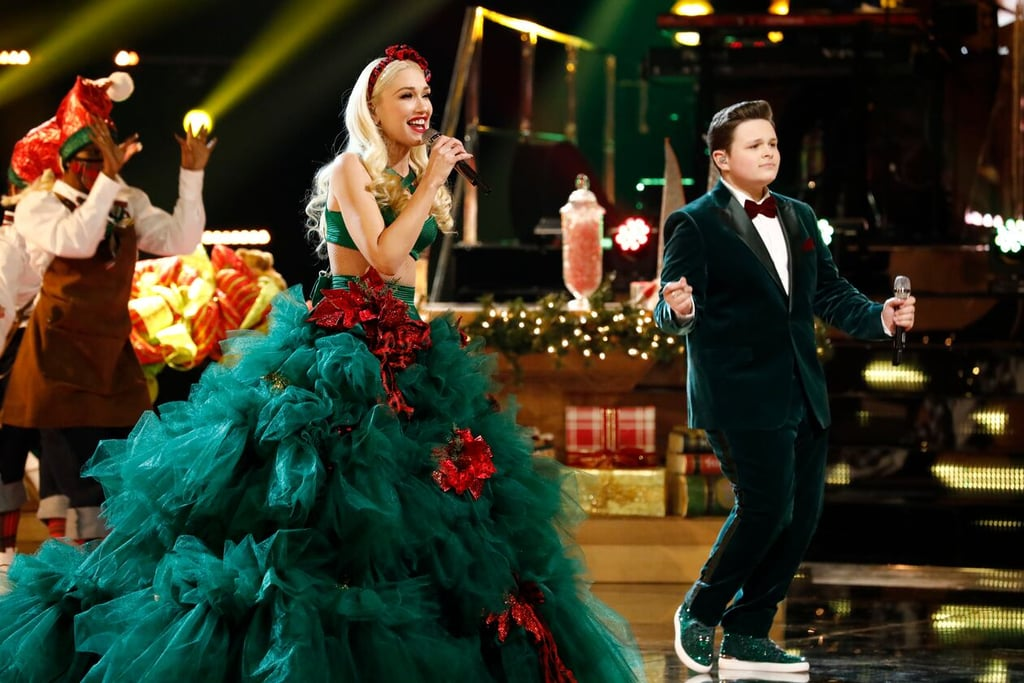 "Gwen Stefani takes holiday dressing to a whole other level, and the singer pulled out all the stops on Tuesday night's finale of The Voice. During her duet performance of ""You Make It Feel Like Christmas"" with finalist Carter Rubin, the singer wore an entire Christmas tree — complete with sparkly ornaments. She paired a sexy bra top with a huge ruffled tulle skirt (with presents hidden under it, perhaps?), and, of course, added a bow headband. And in true Gwen fashion, the star rocked the extravagant custom Christian Siriano outfit like no other. Carter, on the other hand, wore an adorable velvet green tux with a red bowtie to match. Just a few weeks ago, Gwen wore another festive, head-turning look at the Christmas in Rockefeller Center tree lighting concert on Dec. 3. At the event, the  ""Let Me Reintroduce Myself"" singer wore a candy cane-inspired Christian Siriano coordinated set, as well as a pink latex Christian Cowan minidress with two massive bows. Get a closer look at Gwen's latest holiday-themed look ahead."
