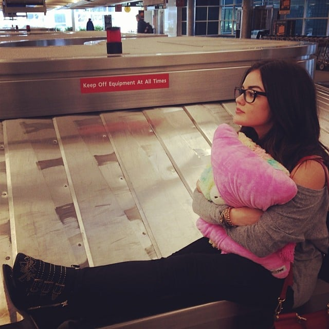 Lucy Hale broke all the rules by sitting on an airport luggage carousel.  Source: Instagram user lucyhale