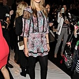 Model Julie Henderson styled a ladylike printed dress with leg-lengthening tights and boots at the BCBGMAXAZRIA show.