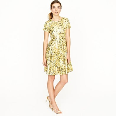 This sweet floral dress can be dressed down or up, and we love that we have flexibility in styling options here. J.Crew Metallic Jacquard Dress ($395)