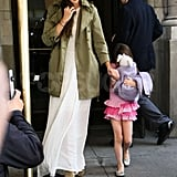 Katie Holmes wore a green trench coat and Suri Cruise wore a striped pink dress in honor of her 6th birthday as they left their NYC apartment.