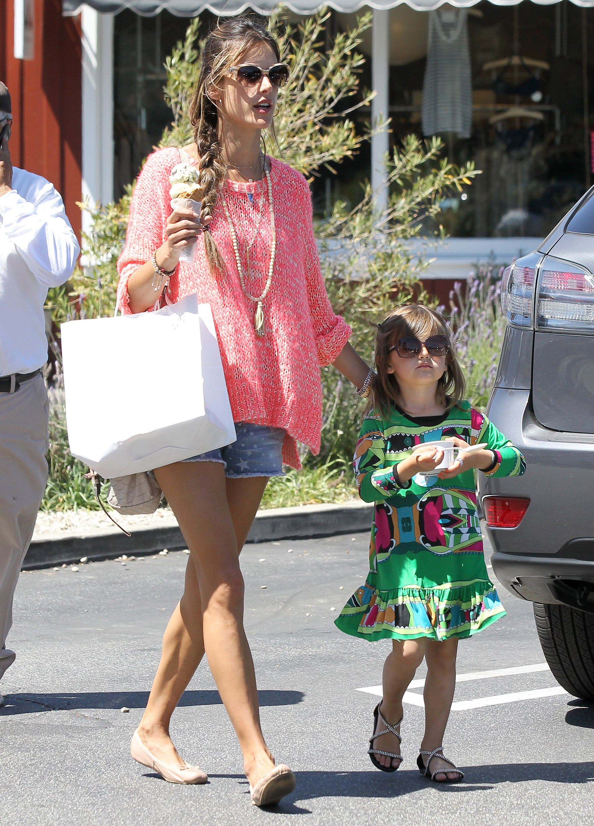 Alessandra Ambrosio created a fun ensemble with a bright pink sweater and Big Star USA star-print denim shorts while grabbing ice cream with her daughter Anja in LA.