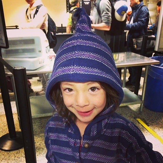 Youngest cast member Aubrey Anderson-Emmons rugged up for the flight. Source: Instagram user theamyanderson