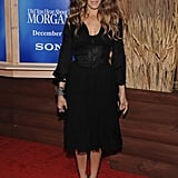 Parker layered stacks on stacks of colorful crystal bracelets, then slipped on a pair of structural python sandals by Nicholas Kirkwood to get her all-black ensemble red carpet ready for the NYC premiere of Did You Hear About the Morgans?