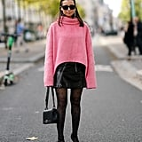 For the all-black clad, consider adding a pink sweater to the mix; we promise you won't regret it.