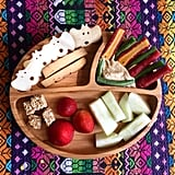 """""""Lunch: purple heirloom carrots and green beans with plain hummus, apples, strawberries, almond quinoa bites, BBQ-smoked tofu sticks and 'boo' chips."""""""
