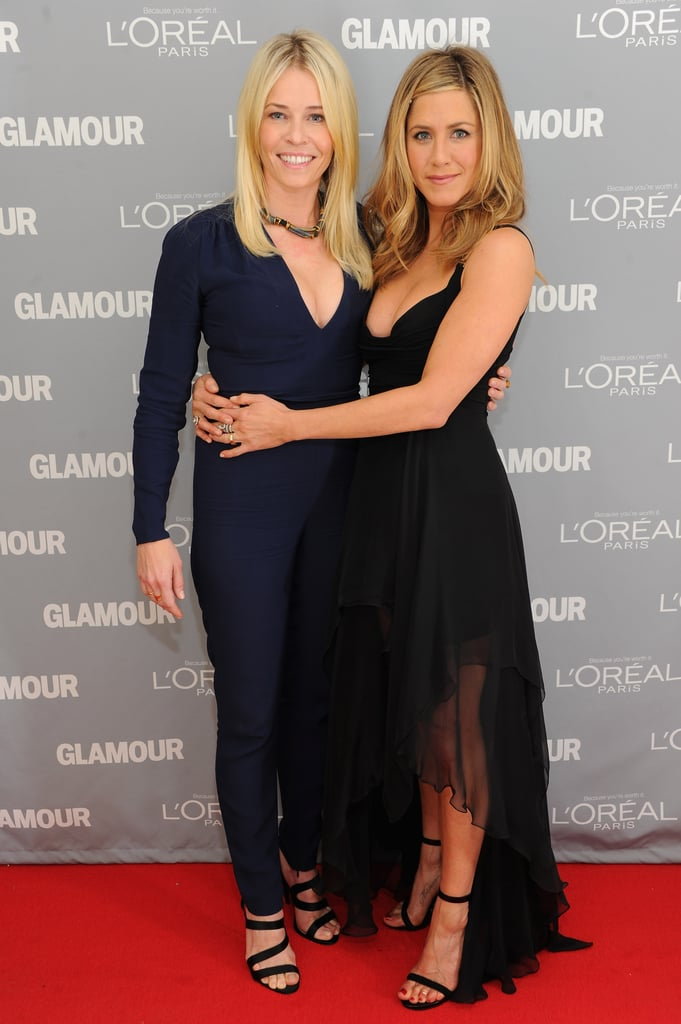 "Jennifer Aniston stepped out in a supersexy black Versace dress to support a Stella McCartney-clad Chelsea Handler, who was among the honorees at Glamour's Women of the Year Awards at Carnegie Hall in NYC Monday evening. On stage Jennifer professed that she is ""madly in love"" with Chelsea and bestowed tons of praise on her funny friend, while also working in a dig about the ""esteemed E! network"" in her presentation speech. Reese Witherspoon took part in the night by participating in the hilarious montage to introduce Chelsea.  The comedienne and late night host played it humble in the presence of fellow women of the evening, including Gloria Steinem and Arianna Huffington. For her part, Chelsea gushed right back about the females in her life and closed out her acceptance by talking about being a good sister and friend since she'll ""never be a mother."" Jennifer actually had her own cheering section at the show, since Justin Theroux slipped in to watch her on stage. Check back for lots more on the Glamour Women of the Year Awards on PopSugar, TrèsSugar, and PopSugar Rush!"