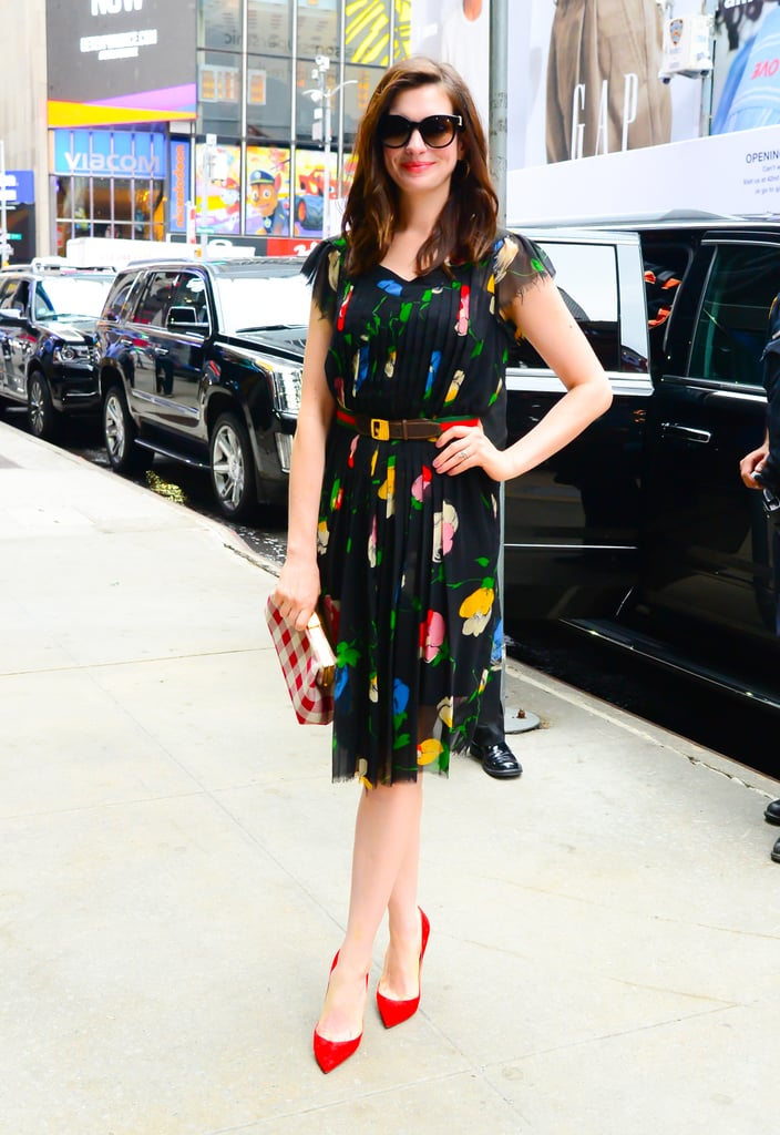 "Leave it to Anne Hathaway to rock a $15 dress on live TV — and own it like it's her damn job. The actress recently made an appearance on Good Morning America to chat about her upcoming role in the film Colossal, but anchor Robin Roberts simply couldn't resist taking a quick detour to ask about her outfit. Anne admitted that she snagged it for a modest $15 at a flea market — what a find! ""I'm trying to be more sustainable with my fashion choices, so I'm trying to wear vintage wherever I can,"" she explained on the show. We really can't argue with that. A multi-coloured knee-length number, her dress has a subtle floral pattern and sheer cap sleeves. She secured a belt around her waist and finished the look with a checkered Mansur Gavriel clutch and red pointed-toe heels. So chic! Ahead, see Anne chatting about her outfit on the show, followed by photos of her thrifted dress from every angle."