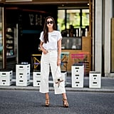 A White Wide-Leg Pair With a White T-Shirt and Brown Strappy Sandals