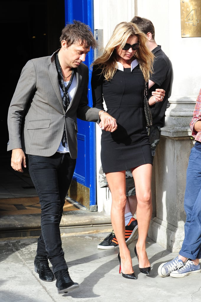 Jamie Hince helped Kate Moss navigate the city sidewalks in her stilettos today as they strolled London together. The engaged pair are back home in England after making a quick stop in Paris last week to toast Kate's collaboration with retailer Mango and photographer Terry Richardson. They're apparently still aiming for a Summer wedding, and Kate may even have chosen her longtime friend Naomi Campbell as her maid of honor. Kate and The Kills front man even have their newlywed digs sorted out! Kate is now the official owner of a home in Jude Law's neighborhood that is said to have cost more than 7 million pounds. The pricey new digs make a fitting home for the star, who earned the distinction of being named one of the world's highest-paid models by Forbes. The magazine estimated that she took home about $14 million in 2010. Kate continues to work steadily after more than two decades in the fashion business, and she currently has the rare distinction of being featured on not one but two separate Vogue covers.