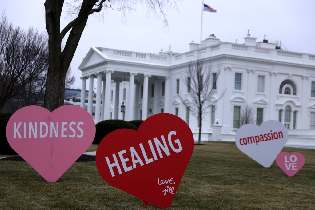 "America's new first lady, Jill Biden, is sending the country messages of love ahead of Valentine's Day. On Feb. 12, giant conversation hearts popped up on the White House lawn decorated with words like ""kindness,"" ""healing,"" ""compassion,"" and more. For Jill, this is a way to celebrate a special holiday with the country from afar.  ""As you may know, the First Lady is known for her sense of humor, love of surprises, and celebrating traditions, especially with her family,"" her spokesperson Michael LaRosa said in a statement. ""Valentine's Day has always been one of her favorite holidays. Sending messages of healing, unity, hope and compassion, this is her Valentine to the country."" A glimpse at the first lady's Instagram page shows she even painted one of the signs with her own signature, giving the project her seal of approval. Get a closer look at the White House hearts, and then catch up on the sweet White House gift Jill recently gave former First Lady Michelle Obama.       Related:                                                                                                                                Jill Biden Makes a Necessary Face Mask PSA — With Help From Champ and Major!"