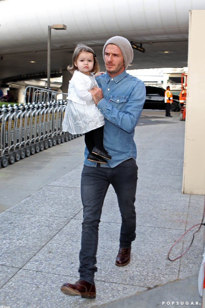David Beckham held onto Harper before their flight.