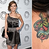 Audrina Patridge has a colorful strawberry snake tattoo on the back of her neck.