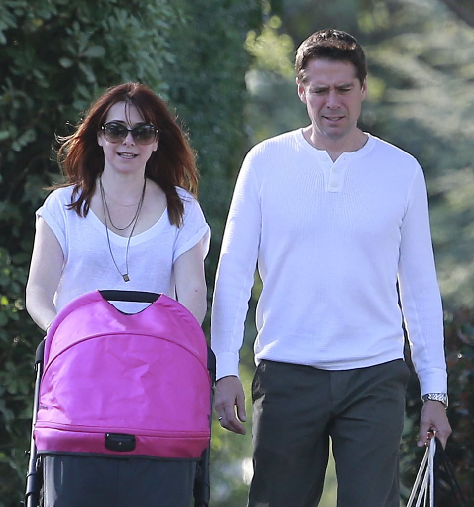 Alyson Hannigan and her husband, Alexis Denisof, took their daughter Keeva for a stroll in LA on Friday.