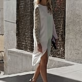 A feminine wisp of a dress, complete with lace sleeves, caught our attention on the streets.