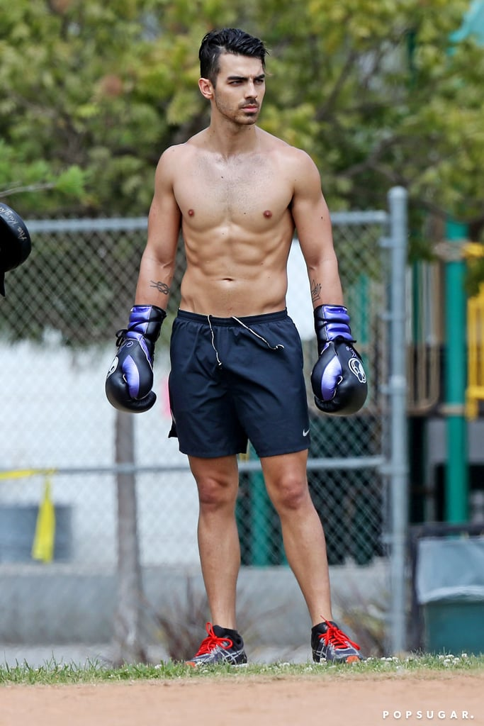 Joe Jonas is certainly swoon-worthy! When the 29-year-old singer isn't making us melt with his voice or showing off his cute romance with fiancée Sophie Turner, he's turning up the heat on social media with his shirtless snaps. While he certainly doesn't post as many selfies as his younger brother Nick, he has shared quite a few sexy snaps over the years. Get ready to catch the love bug as you look through some of his hottest moments ahead!