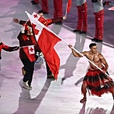 Tongan flag bearer Pita Taufatofua makes a dramatic entrance.