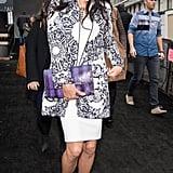 Adriana Lima wearing a Desigual coat.