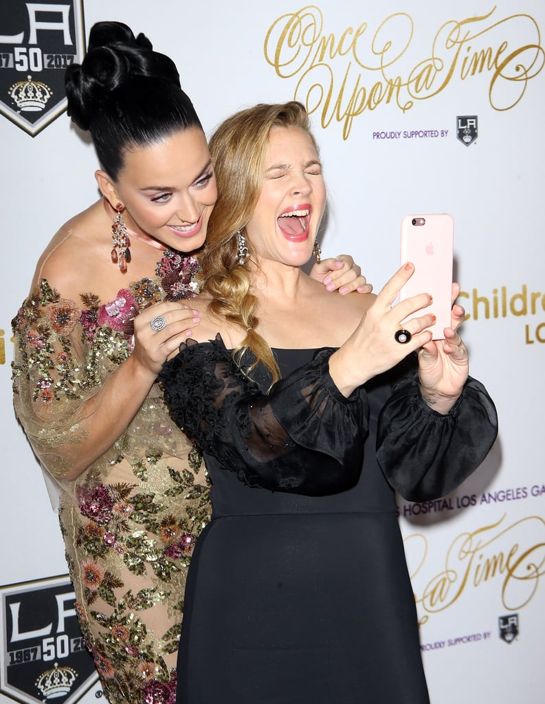 """Drew Barrymore feels just as strongly about Katy Perry as you do. While attending the 2016 Children's Hospital Once Upon a Time Gala in LA on Saturday night, the actress totally freaked out when she got the opportunity to snap a selfie with the """"Rise"""" singer and pose with her on the red carpet. Drew, who was being honored at the event for her philanthropic efforts, shared the selfie on Instagram later that night, writing, """"Oh yeah! And this happened!!! @katyperry my fellow @childrensla representative tonight at the gala!!! #loveher #roar me and my daughters listen to her with such joy!"""" The gala celebrates the children, doctors, researchers, and caregivers who change lives through discovery and compassion, and it included additional appearances by Josh Gad, Jamie Lee Curtis, and Eric Stonestreet.       Related:                                                                                                           These Pictures of Drew Barrymore Will Remind You Why She's Always Been the Best"""