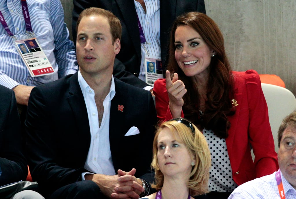 Kate Middleton attended her second Olympic event in London this afternoon when she popped up at the swimming finals with Prince William. Kate chose a patriotic polka-dot top and bright red blazer for her latest appearance, after sitting in the stands earlier today to cheer on Great Britain's field hockey team in a blue jacket. It's been a busy week for Kate and William, who have been making the rounds since the opening ceremonies last Friday. The couple showed sweet PDA while watching track cycling yesterday and were likewise animated during this outing. Kate covered her face with her hands in between cheering and chatting with her husband. Make sure to check out all the Olympic fun as we continue to cover the action at the Games.