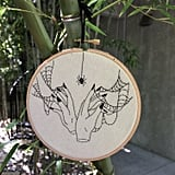 The hands and spiderweb embroidery ($50) combines two of your worst nightmares: seeing a spider and being entangled in its webs.