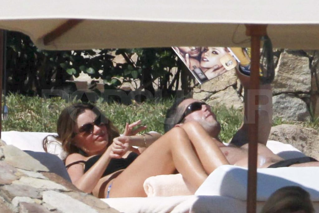 "Sofia Vergara donned a sexy black two-piece for a little rest and relaxation with her boyfriend Nick Loeb in Cabo yesterday. Sofia shaded her face with an oversize hat while Nick soaked up the sun shirtless. The couple got out of town right after Sofia celebrated President Clinton's 65th birthday on Thursday night. Sofia's in the middle of filming the third season of Modern Family and took a break from work to enjoy a mini vacation. Sofia and Nick indulged in ""real Mexican"" food when they weren't busy lounging poolside and showing sweet PDA in their skimpy outfits. Sofia's swimwear meant that she wasn't modeling anything from her new collection with KMart, but she's been promoting the line lately and wore a few pieces during a recent night out with Nick."