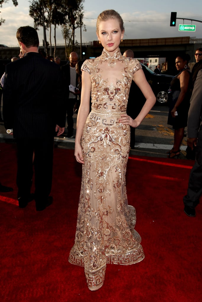 Taylor Swift wore Zuhair Murad to the 2012 Grammys. She posed for photos on the red carpet before heading inside. The winning has already started for Taylor, who recently found out that she's the proud owner of two new statues for best country song and best country solo performance. She's also up for best country album, as is George Strait, Blake Shelton, Lady Antebellum, Eric Church, and Jason Aldean. Make sure to weigh in on Taylor's golden look with our love it or hate it Grammys polls!