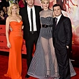 Elizabeth Banks, Liam Hemsworth, Jennifer Lawrence, and Josh Hutcherson posed together on the carpet.