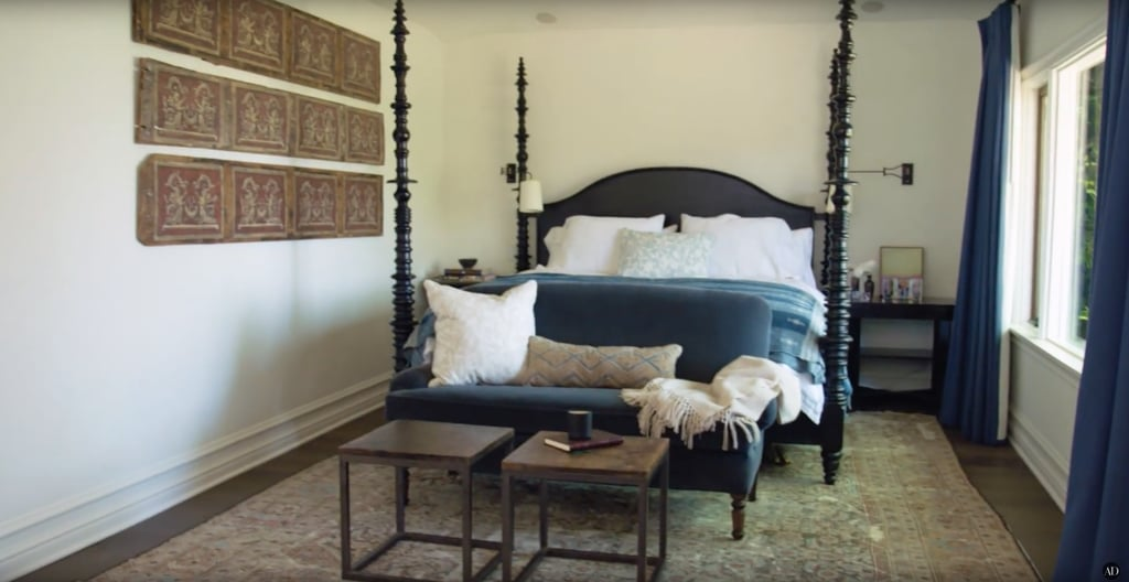 The master bedroom features a custom bed and pillows.