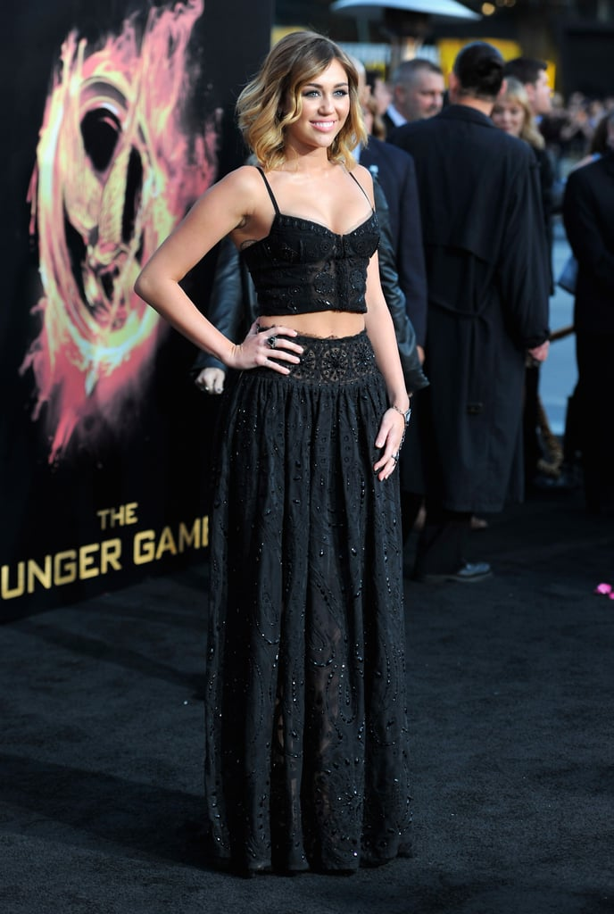 Miley Cyrus's Emilio Pucci ensemble is fresh, youthful, and totally sophisticated . . . a playfully sexy choice for the LA premiere of The Hunger Games.