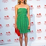 Taylor Schilling went for Summer minimalism — styling a strapless green dress with nude pumps and a red clutch. The key here is cool pops of color to punch up the basic pieces.