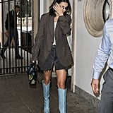 Kendall Jenner Wore a Striped Blazer with Black Denim Shorts and Light Blue Fendi Cowboy Boots