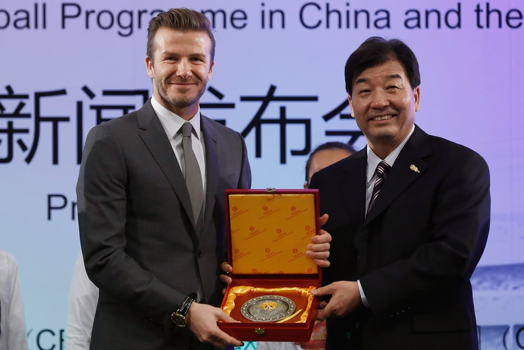 David Beckham received a medal on stage.