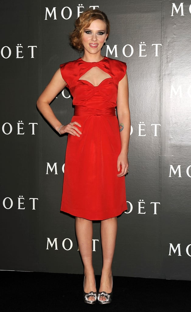 In vintage red Givenchy with a sweetheart cut-out, Scarlett got our attention at Moet & Chandon's Tribute to Cinema in October 2009.