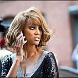 Tyra Banks chatted on her phone with her hair and makeup done for NYFW.  Source: Instagram user cutblog