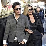Kate Moss got comfortable on the arm of Jamie Hince in Paris.
