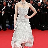 Jessica Biel turned up the glamour for the Inside Llewyn Davis premiere at the 2013 Cannes Film Festival, wearing an ultratextured, strapless Marchesa dress cut to reveal a feather underlay with a bejeweled serpent collar necklace, Marchesa clutch, and nude pumps.