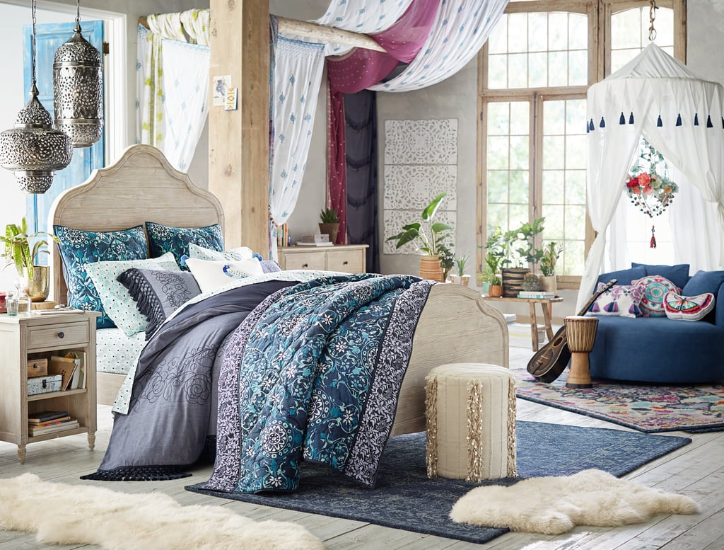 Products pictured: Medallion Tapestry Quilt + Sham ($36-$209), Indigo Printed Overdye Rug ($169-$699), Free Spirit Canopy ($199),  Embroidered Sheer ($69-$99), Embroidered Tassel Duvet Cover + Sham ($36-$189)