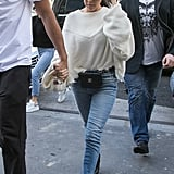 Styling Her Sunglasses With a Baggy White Sweater and Skinny Jeans