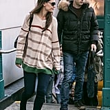 Katie Holmes got out of the subway with a male companion.