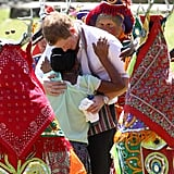 Harry hugged a girl among deer dancers during a visit to the Xunatunich Mayan Temple in 2012.