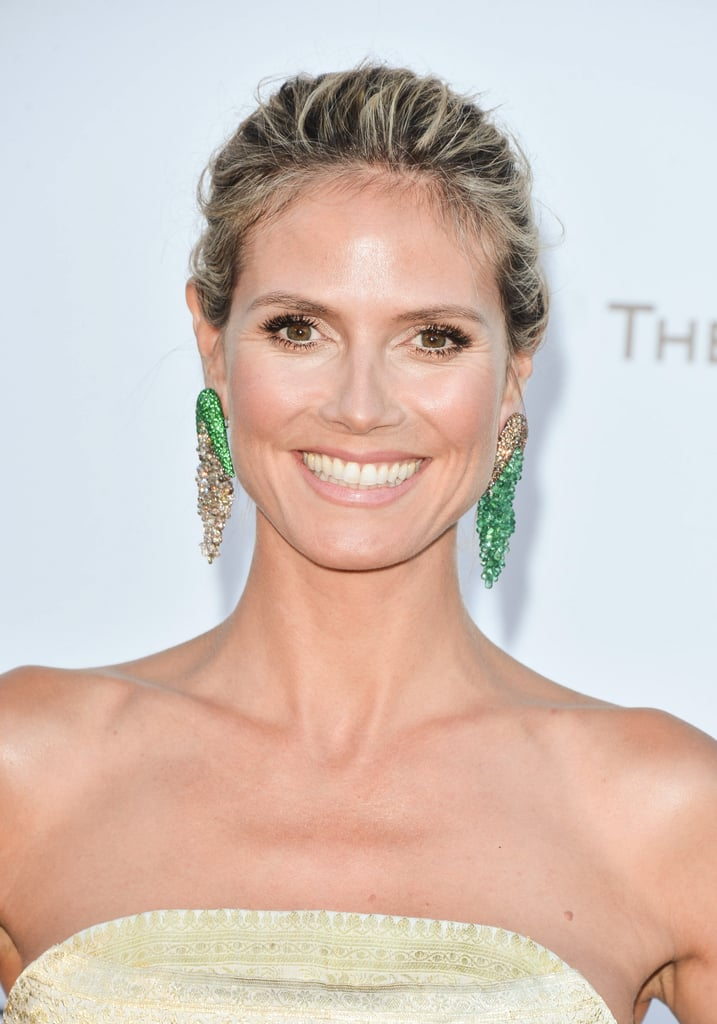 Heidi Klum wore her hair pulled back into an updo, and she kept her makeup natural-looking to let her bold earrings be the focus of her ensemble.