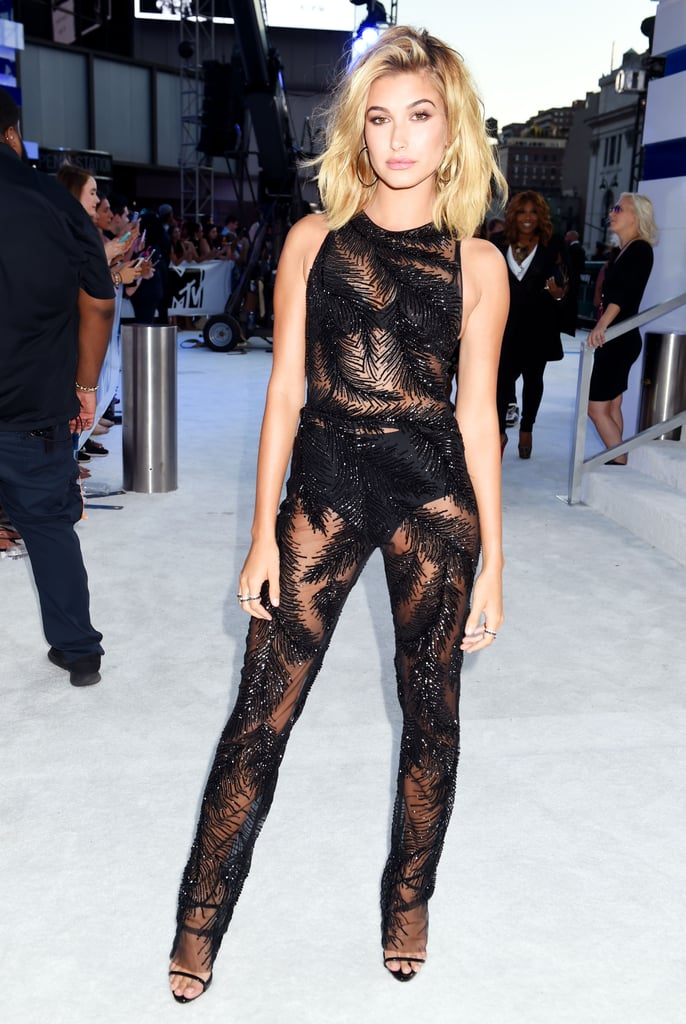 For a winning one-and-done look at the VMAs, Hailey Baldwin went with a sexy, sheer jumpsuit. The Georges Chakra number had special details throughout, such as an eye-catching leaf print, which slightly and strategically covered the model's undergarments. Hailey clearly loved the one-piece as much as we do, as she was spotted smiling and taking selfies with a handful of fans. Read on to see her outfit from all angles.