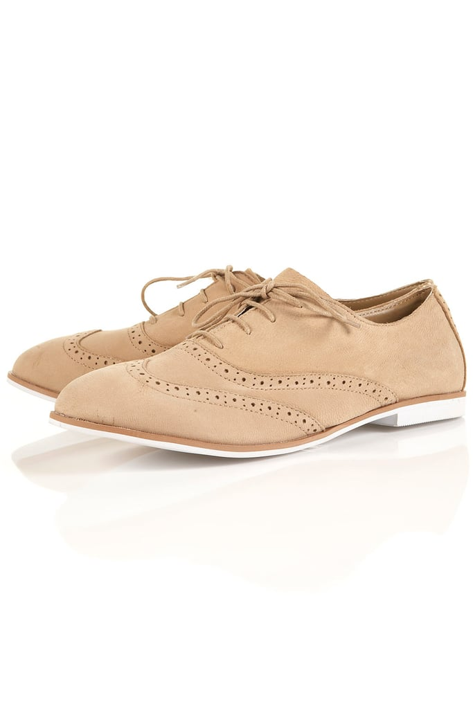 Equal parts comfortable and cool — not to mention on trend — we love these brogues for their versatile nude hue and the cool menswear vibe they'll lend our Spring and Summer dresses.  Topshop MEL Tan Leather Brogues ($64)
